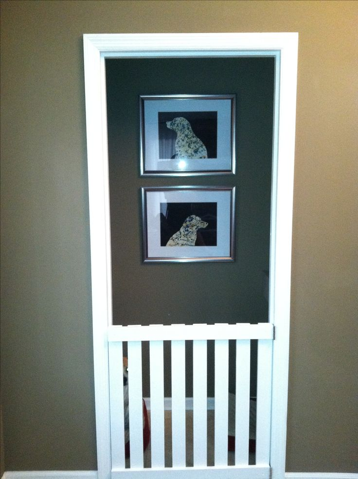 This is my front closet that I converted into a dog pen...the artwork is silhouettes that I made of my two dogs :)
