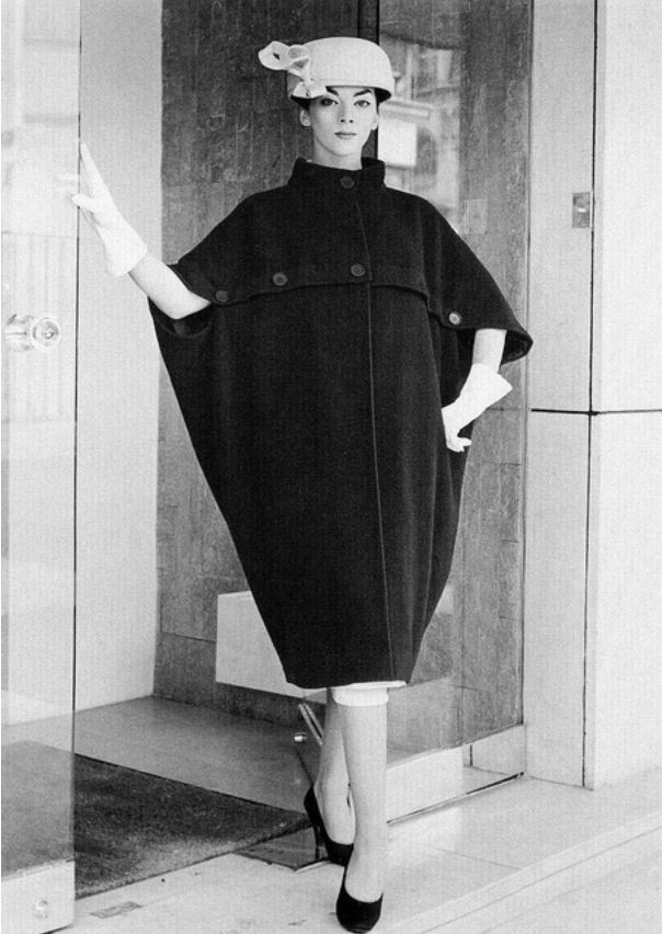 1957 Regine Debrise is wearing black wool coat by Balenciaga, photo by Seeberger