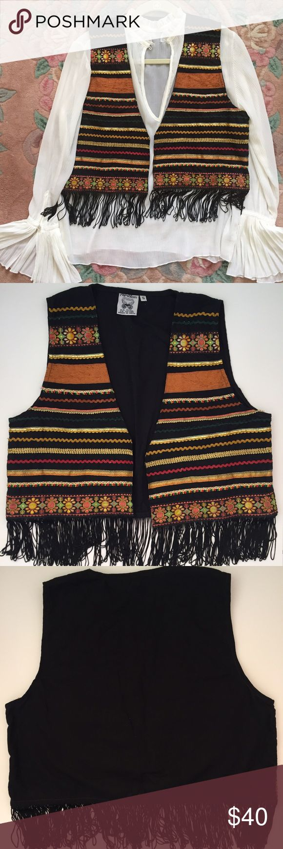 "Papillon Bohemian Fringe Vest Super cute vest with black fringe. Embroidered ribbon and rick rack trim. Size small. Looks super cute with a boho flowy blouse. Measures 21"" from shoulder to bottom of fringe. Says size small but could fit up to a medium. Like new. Made in India. Papillon Jackets & Coats Vests"