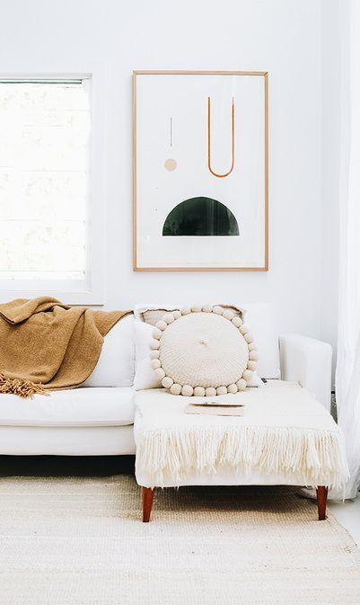 Pampa cushion, rug and throw with Bobby Clark artwork at Yoli+Otis Byron Bay abode, shot by Kara Hynes for Grace Magazine