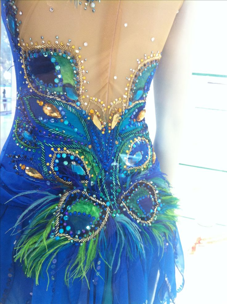 Mixing elements of bugle beads, crystal rhinestones, sequins and feather embellishments creates a mixed media piece- and can cost less than the average!