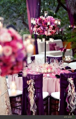 Love the romantic pink and purples. ~Sarah   Beautiful #centerpiece with #candles...nice for a #wedding party!