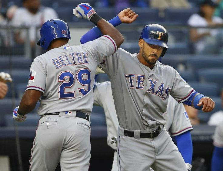 Adrian Beltre #29 of the Texas Rangers is congratulated by Ian Desmond #20 after the two scored on Beltre's two-run home run against the New York Yankees during the first inning at Yankee Stadium on June 28, 2016. (Photo by Rich Schultz/Getty Images)