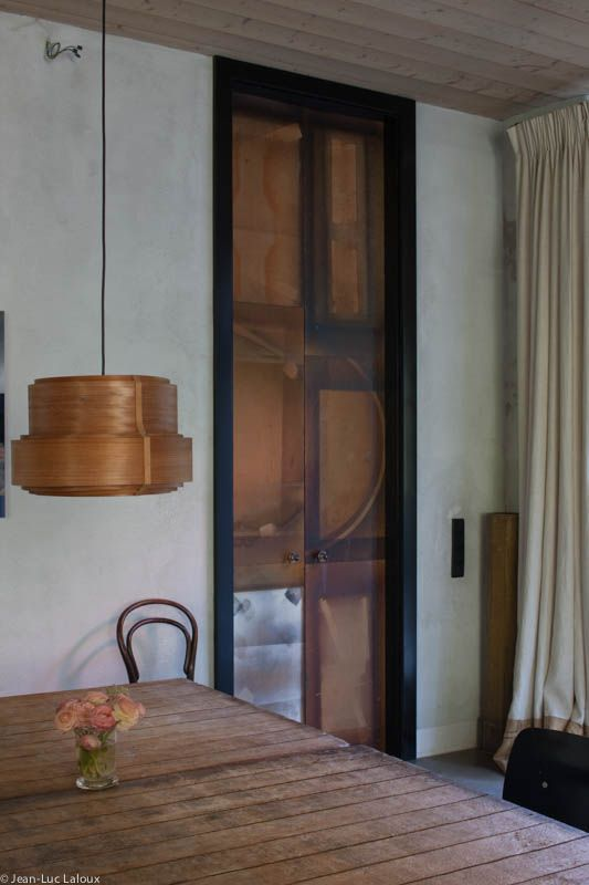 A reclaimed wood door becomes a focal point in the room #interiordesign #design #interiors #bespoke #homes #designer