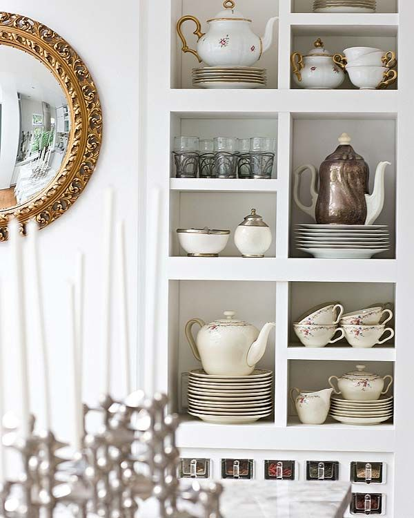 Love the gold mirror in the kitchen and the tea pots and tea cups in the open shelving