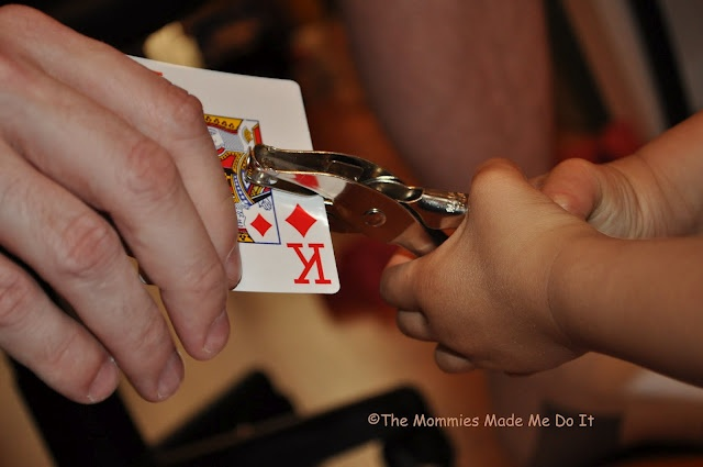 Fine Motor - Hole Punch - Develops Hand Muscles - Use Cheap Playing Cards To Give Them Something To Aim For &/or 'Punch 5 Holes In The 5 Card' Etc.