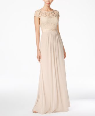 An embellished waistline elegantly defines this sweeping lace-bodice gown by Adrianna Papell. | Shell: viscose/cotton/nylon/polyester; lining: polyester | Spot clean only | Imported | Illusion scoop n