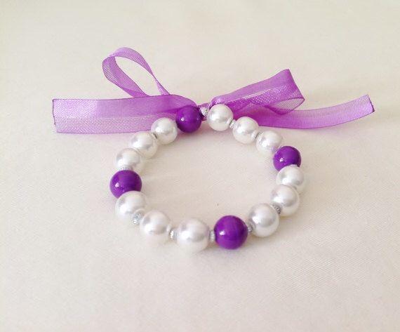 A personal favorite from my Etsy shop https://www.etsy.com/listing/182420136/elastic-pearl-kid-bracelet-little-girl