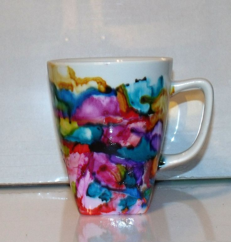 A 12 oz stoneware mug painted by my wonderful kids. Winter creations designed and named by the CasaKid's.