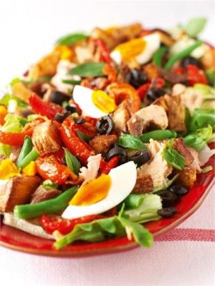 Salade Nicoise Recipe:  Lettuce bottom, then potato (diced, boiled, and mixed with mayonnaise/seasoning/chives), then tuna, then everything else. Use fresh ripe tomatoes instead of this recipe's sunblushed ones, and capers are a lovely addition!