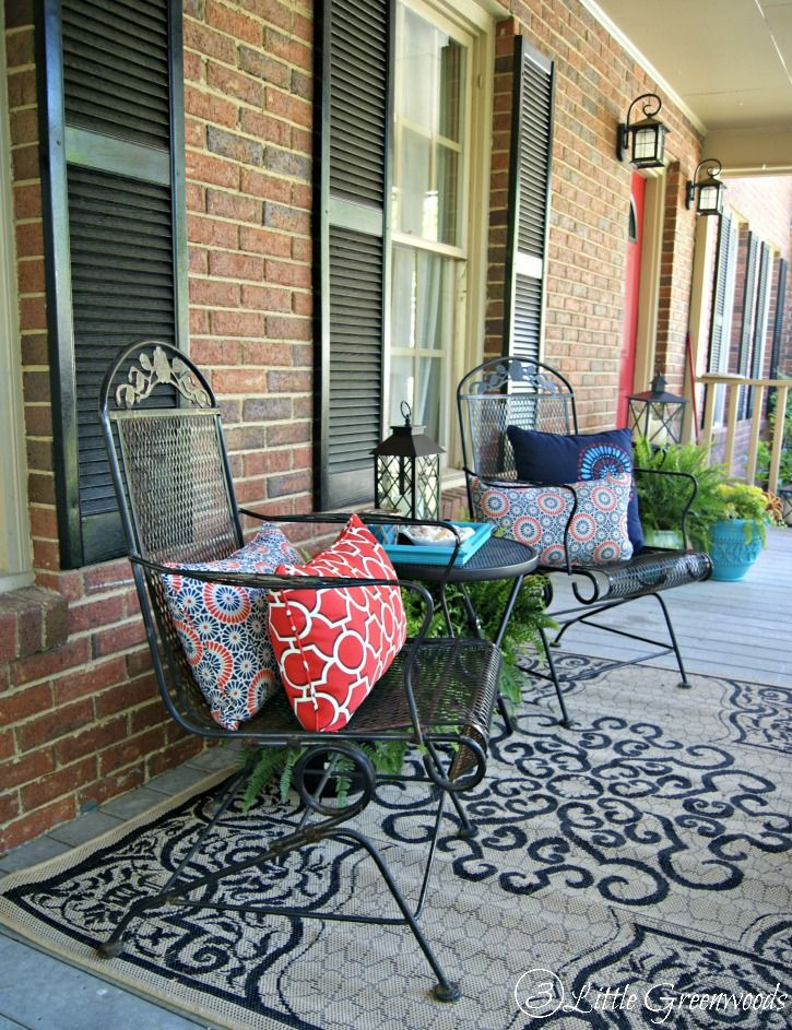 Refresh your home with southern front porch decorating for Patios decorated for christmas