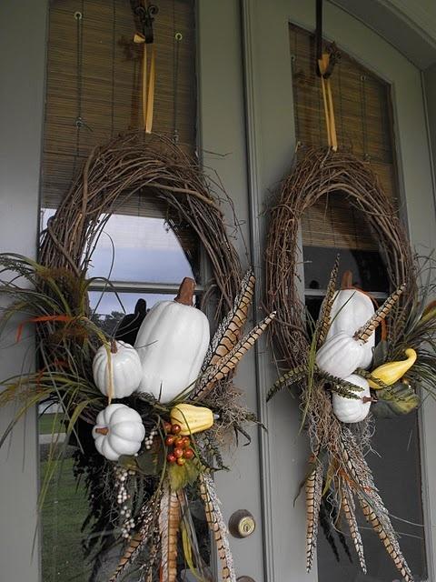 Autumn wreath. White pumpkins look good on a dark door.