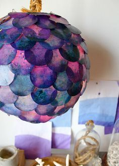 Something to keep your creative juices flowing :P  We came across this innovative lamp called the Fish scale lamp, which can be made in your homes in an afternoon!  The material needed are a white paper globe lantern,paper circle cutter, Dye, paraffin wax, mineral oil, crock pot, extra bowl & a glue gun.