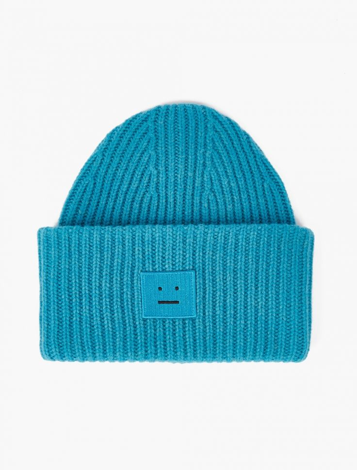 The Acne Studios Pansy Wool Hat for SS17, seen here in turquoise. Crafted from premium wool and cut to offer an oversized fit, Acne presents their take on the classic beanie hat for SS17, with this particular style finished with the brand's recognisable face patch to the centre front.