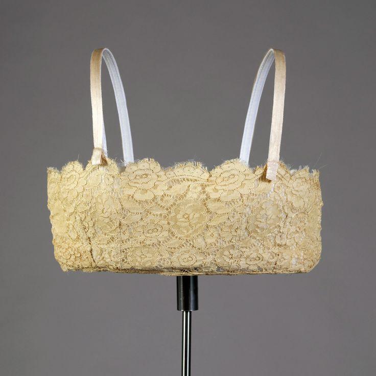 Brassiere, American, ca. 1925. Ecru colored machine lace bandeau; straps of silk ribbon. Gift of J.B. Britton in memory of Katherine Lynch Bates, KSUM 1985.4.17