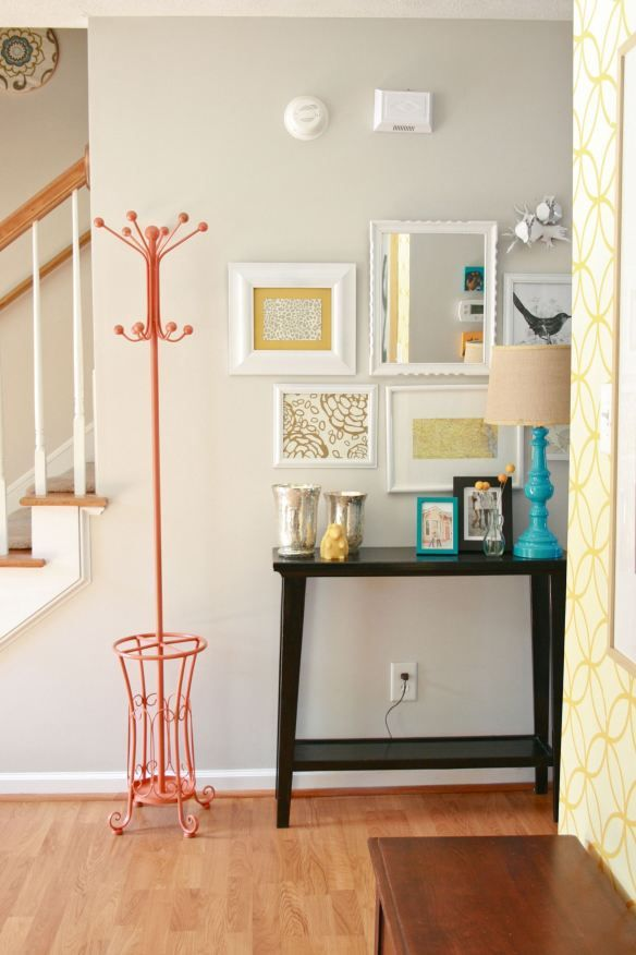 love this entry way with the orange coat rack (!!) and the lamp