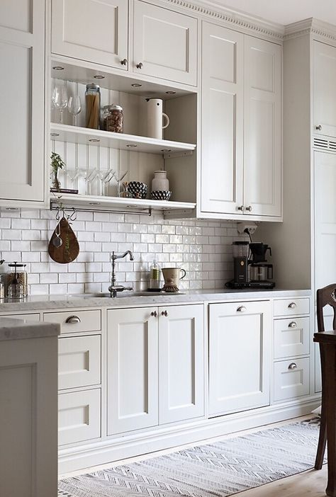 Cabinets that go up to the ceiling. Love the detail - one large door that looks like two