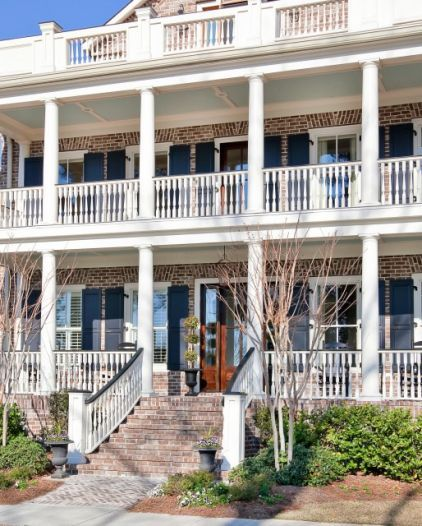 I love this brick, yes, brick, home with all the balconies and columns.