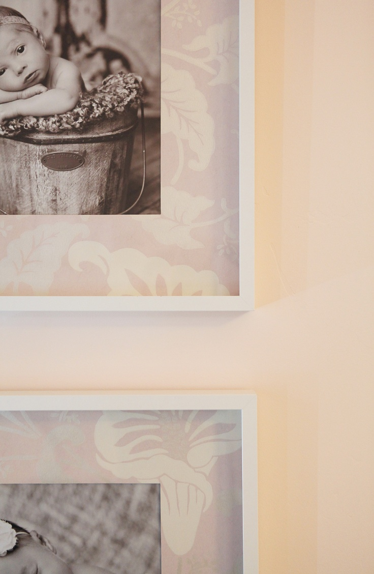 Use leftover wallpaper as the background for framed photos. I think handmade papers would be great too. From The Modern Sophisticate blog