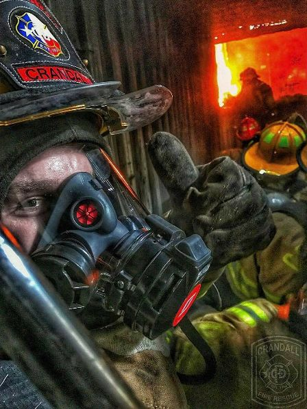 A Crandall Fire and Rescue firefighter gives the thumbs up during a flashover fire training. | Shared by LION