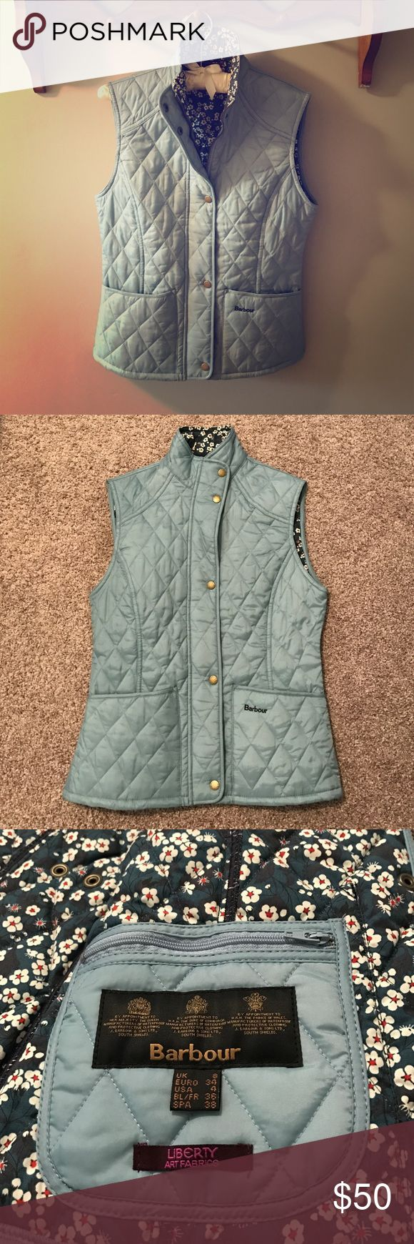 Barbour blue quilted vest with ditsy floral lining Really cute limited edition Barbour vest. Liberty of London floral lining. Light blue quilted nylon exterior. Cotton interior. Barbour Jackets & Coats Vests