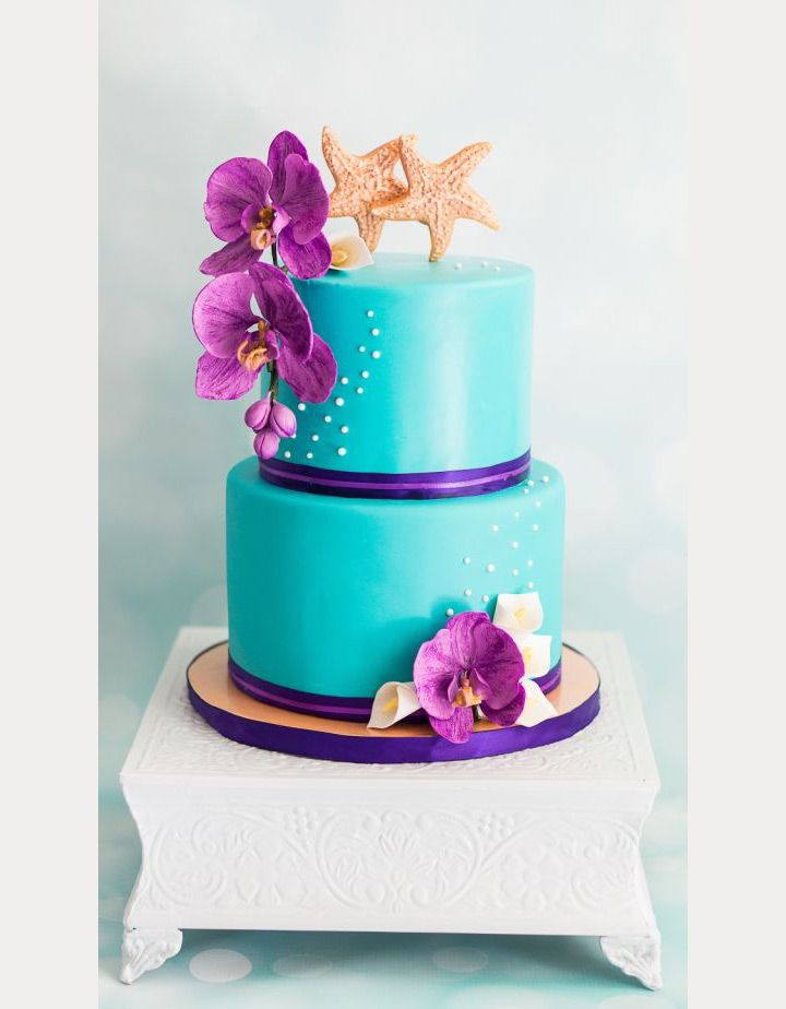gorgeous turquoise beach wedding cake with purple orchid accents ~  we ❤ this! moncheribridals.com