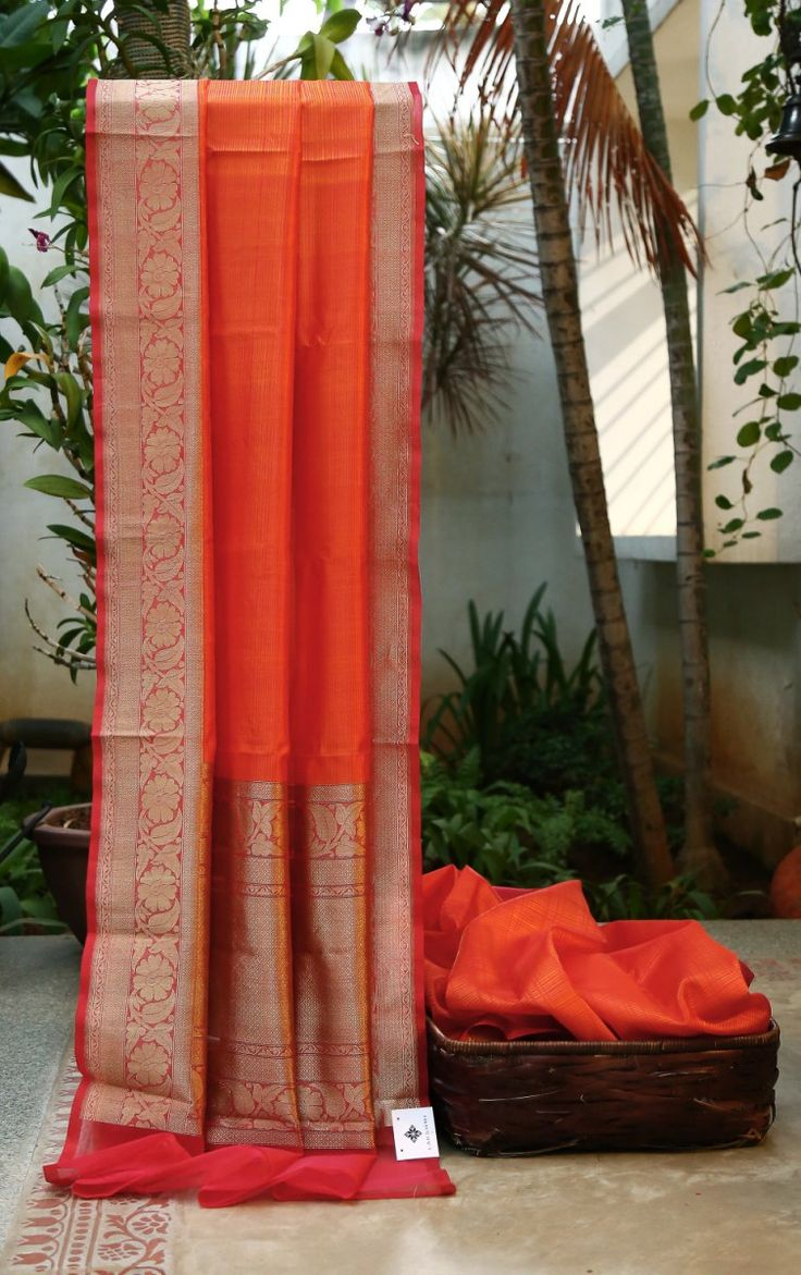 Texture orange kora silk with a beautiful woven gold border. The intricately woven pallu finishes the piece beautifully