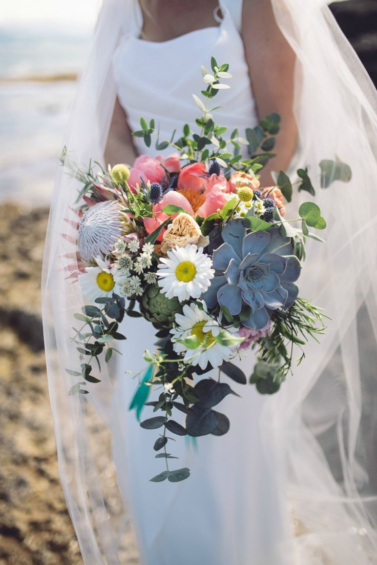 Succulent and wildflower wedding bouquet. Photography by Jenna Woodward