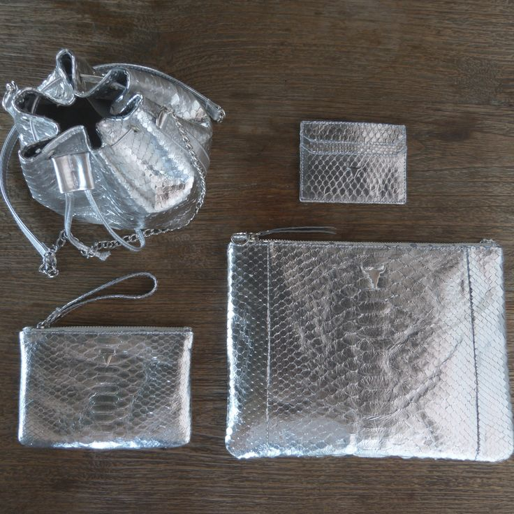 Our DIVINE collection in silver python, LANA cardholder, AMBER, LILY clutch and the CARA bag available