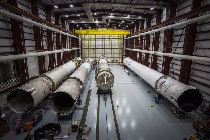 SpaceX hangar with 4 landed Falcons inside.