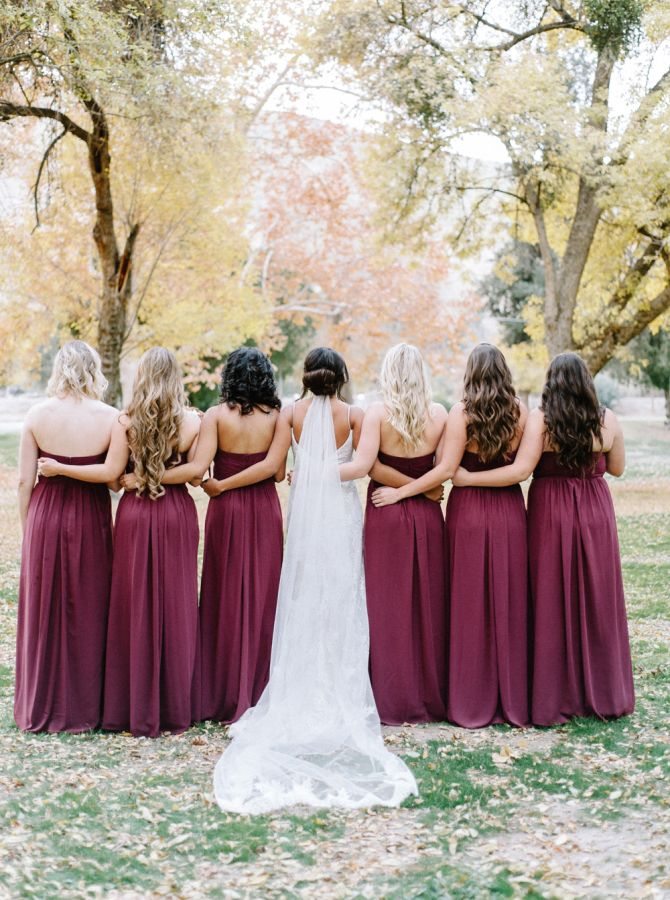 Pretty berry fall bridesmaid dresses: http://www.stylemepretty.com/2016/03/01/fall-rustic-chic-backyard-wedding/ | Photography: Mariel Hannah - http://www.marielhannahphoto.com/