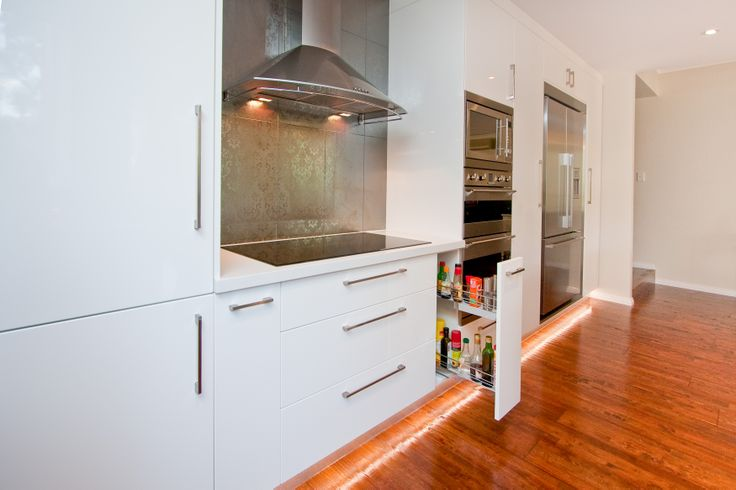 Keep sauces and oils handy to the hotplate in your new kitchen design. www.onecallkitchens.com.au
