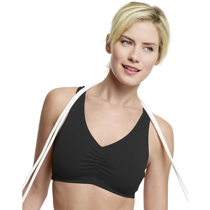 Style and comfort in a comfortable low-impact sports crop top. 2-ply construction with pretty shirred front. Sporty racerback, crop top styling. Cotton/spandex fabric that moves with you. Low-impact support ideal for yoga, pilates or weight training.