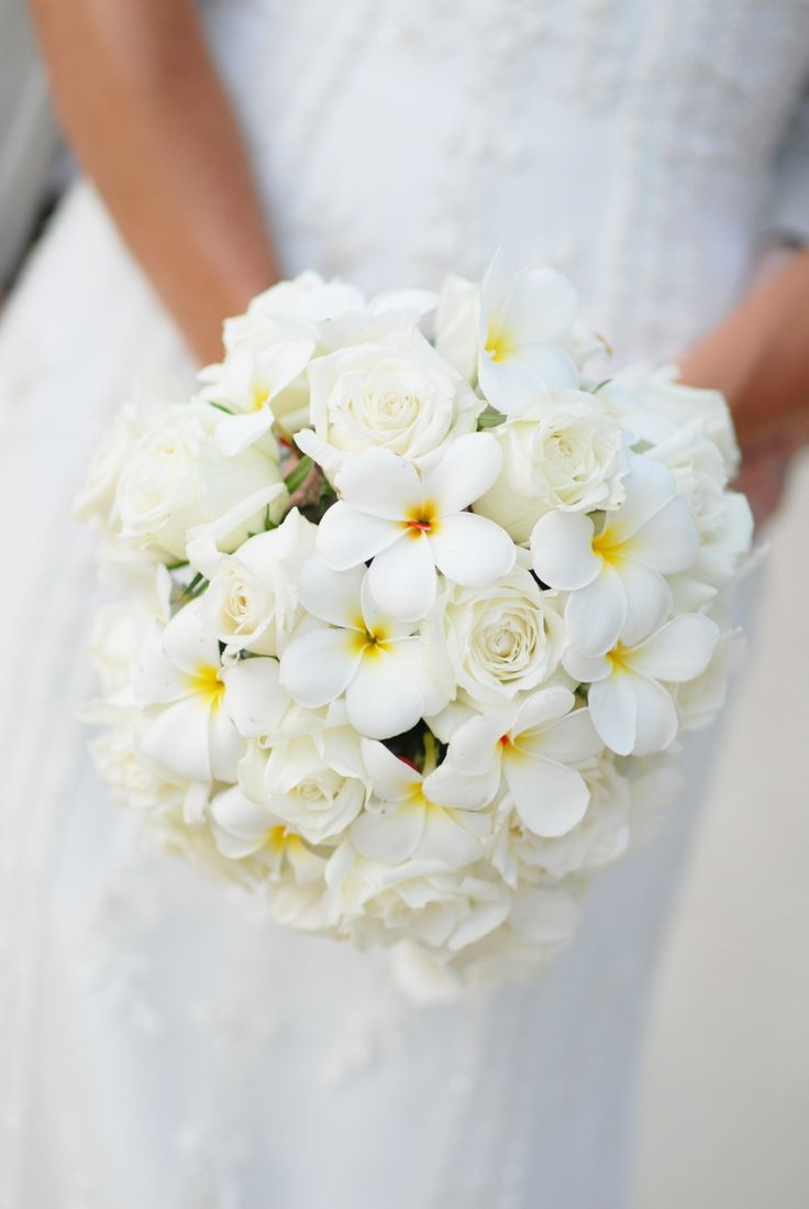 Posey; White roses with white& yellow frangipani. Weddings in Thailand