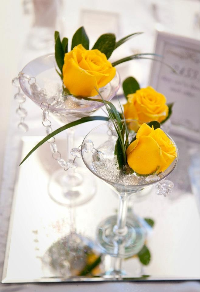 Beautiful yellow rose in martini glass centrepiece