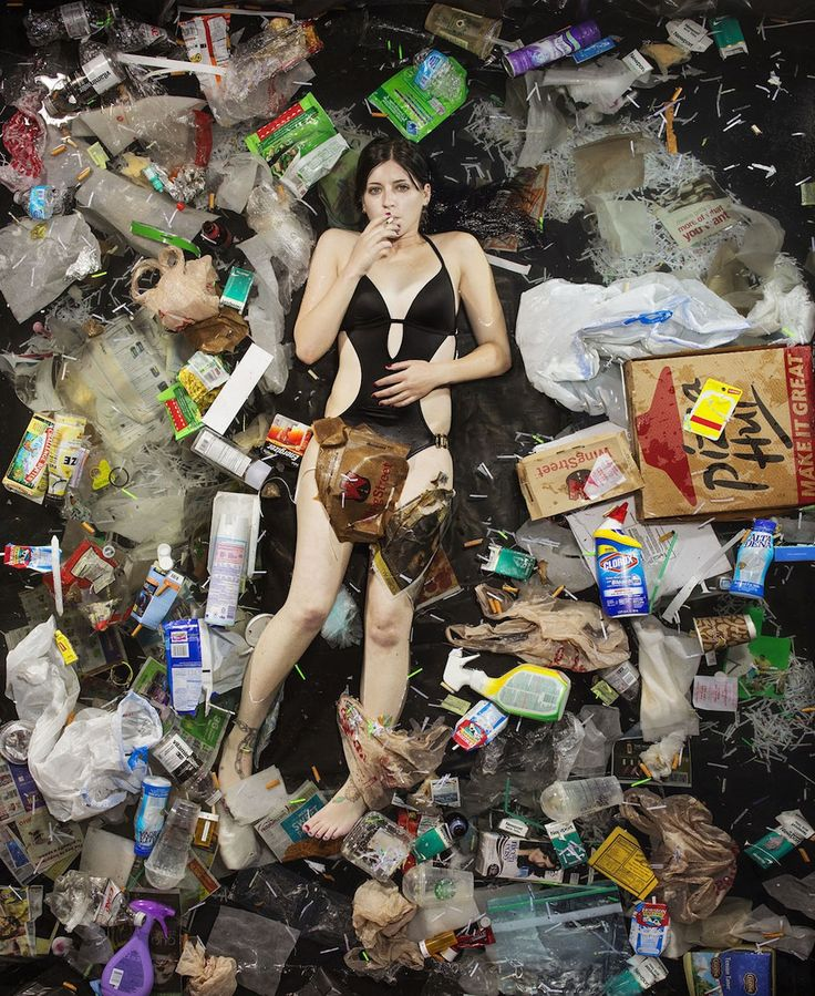 """Photographer Gregg Segal's 7 Days of Garbage photo series.  """"7 Days of Garbage is a series of portraits of friends, neighbors, and other acquaintances with the garbage they accumulate in the course of a week. Subjects are photographed surrounded by their trash in a setting that is part nest, part archeological record. We've made our bed and in it we lie."""""""