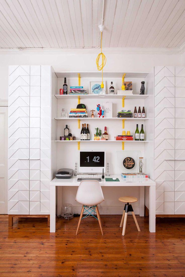 Cute work space. Yellow shelf brackets and lamp cord.