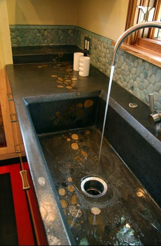 Gorgeous concrete sink with embedded rocks.