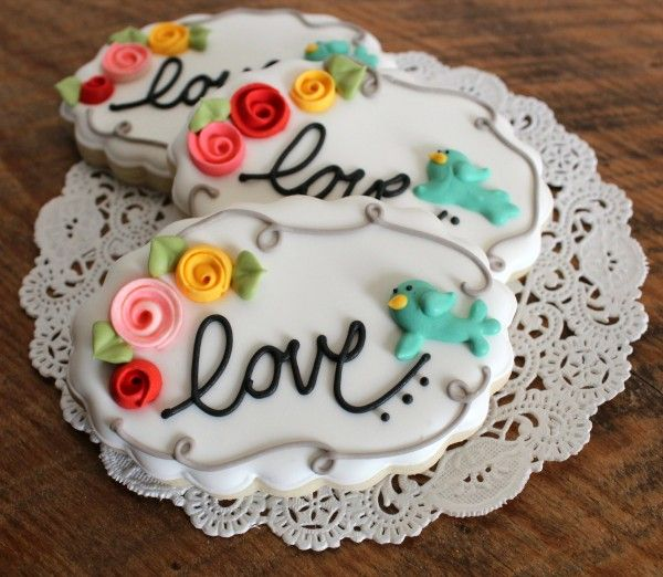 Elegant rose and birdie cookies - by Sweet Sugar Belle. We have a friend who just got engaged...so sweet!