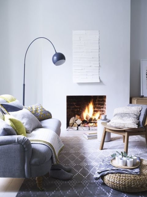 Everyday luxury: Add extra comfort to seating with a toning mix of patterned and plain cushions in linen and wool.