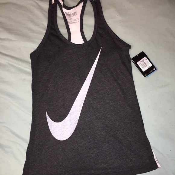 Brand new Nike tank top!! Bought it thinking it was an XL but got it home & it was an XS!! Nike Tops Tank Tops