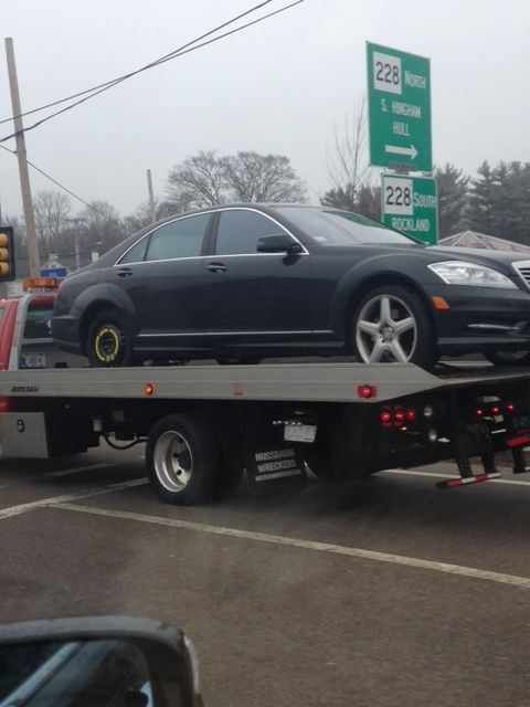 car being towed after second flat in a day 2013 mercedes S550