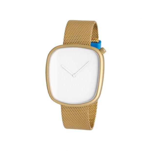 The Pebble was designed by Danish supergroup KiBiSi, led by architect Bjarke Ingels, industrial designer Lars Larsen and design entrepreneur Jens Martin Skibsted. #watches #design