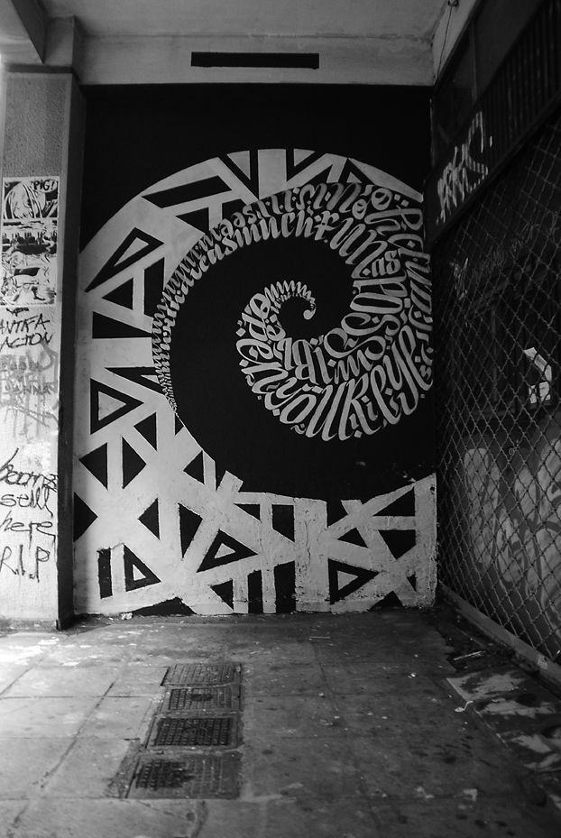 """Blaqk is a collaboration between Greg Papagrigoriou and Simek, a pair of street artists from Athens, Greece. They form these beautiful geometric shapes with a blend of typography and calligraphy."""