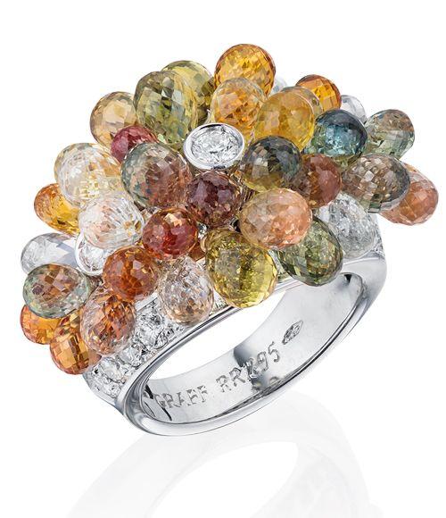 GRAFF КОЛЬЦО С ЦВЕТНЫМИ САПФИРАМИ Цена у нас 33,500 $Кольцо из платины и белого золота с бриллиантами и цветными сапфирами. 33 бриллианта Цвет FW Чистота VS. 37 цветных сапфиров.