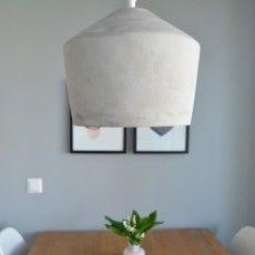 Concrete pendant lamp hanging above kitchen table   Corner 2 designed by Finnish designer Matti Syrjälä for Sessak