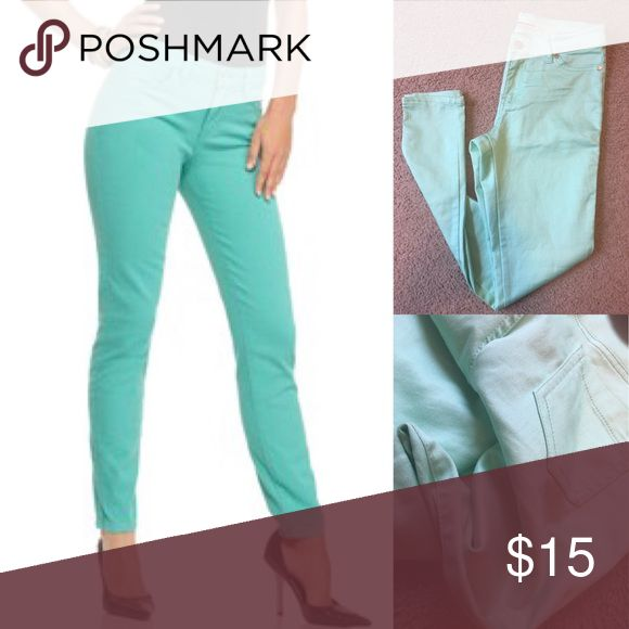 Teal skinny jeans size 8! There's fit true to size, and very fitting! In good shape (one flaw is pictured has a small mark on the side in the back) barely noticeable Express Jeans Skinny