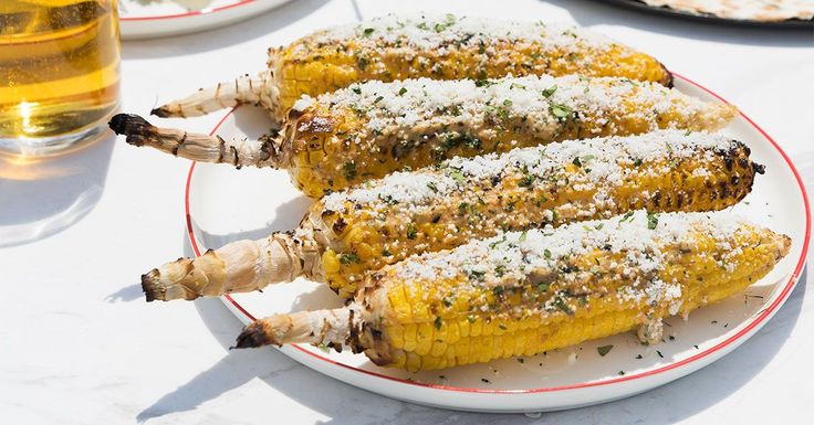 For the ultimate Mexican street food, brush grilled corn with a mixture of cotija cheese, mayo, sour cream, chile powder and lime before topping it with more cheese.