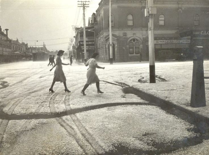 Two women cross Margaret St. after a hailstorm, Toowoomba, Queensland, ca. 1943 / Local History and Robinson Collections, Toowoomba City Library, http://twbspydus8.toowoombarc.qld.gov.au/cgi-bin/spydus.exe/FULL/PIC/BIBENQ/370596/3126702,2 | thefashionarchives.org