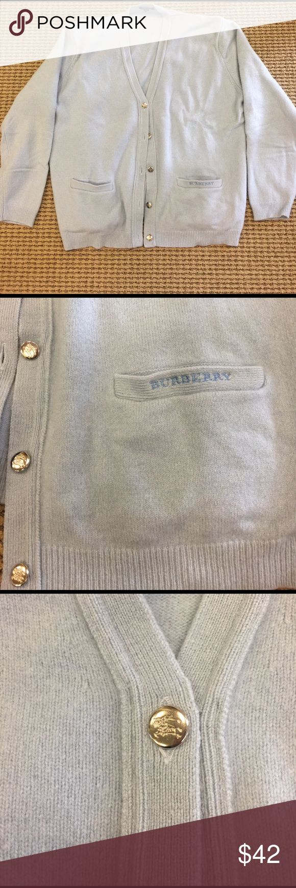 Burberry light blue wool cardigan boxy fit size XL Really soft baby blue wool Burberry cardigan. Super stylish boxy oversized fit. Would fit 10-16. Marked size euro 44. Low v neck. Logo on silver buttons and Burberry monogrammed on pocket. Cute and warm over a white t-shirt or blouse with jeans. Bundle for discount. Burberry Sweaters Cardigans